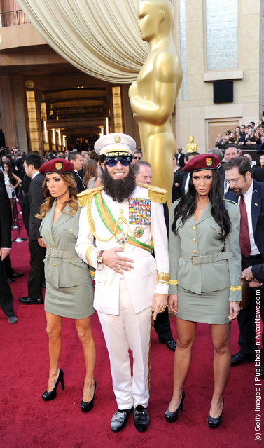 Actor Sacha Baron Cohen, dressed as his character 'General Aladeen,' arrives at the 84th Annual Academy Awards held at the Hollywood & Highland Center