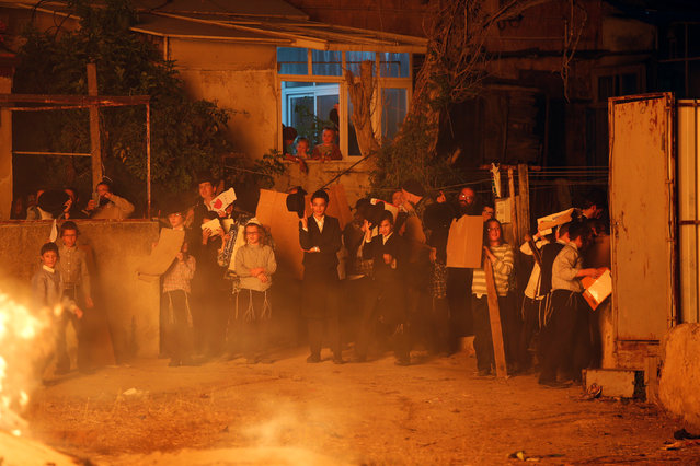 Ultra-Orthodox Jews stand next to a bonfire during celebrations for the Jewish holiday of Lag Ba-Omer in Jerusalem's Mea Shearim neighbourhood May 25, 2016. (Photo by Ronen Zvulun/Reuters)