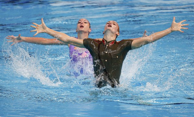 Aleksandr Maltsev and Darina Valitova from Russia perform in the synchronised swimming mixed duet technical routine preliminary at the Aquatics World Championships in Kazan, Russia July 25, 2015. (Photo by Michael Dalder/Reuters)