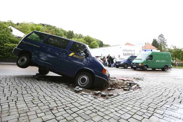 A damaged car is pictured after floods in the town of Schwaebisch Gmuend near Stuttgart, Germany, May 30, 2016. (Photo by Michaela Rehle/Reuters)