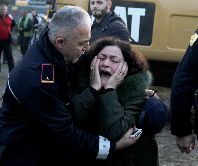A woman cries as her relatives are trapped in a building after an earthquake hit Thumane, Albania, 25 November 2019. Albania was hit by a 6.4 magnitude earthquake on 26 November 2019, leaving three people dead and dozens injured. (Photo by Malton Dibra/EPA/EFE)