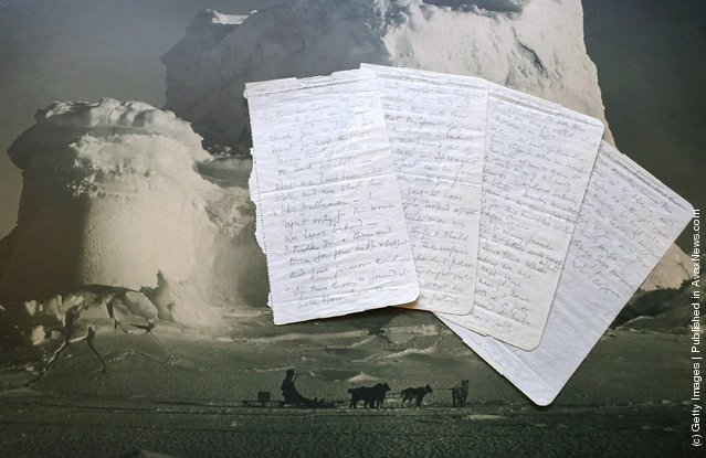 he final letter written by Captain Robert Falcon Scott before his death is displayed on a Herbert Ponting photograph 'The Castle Berg' at Bonhams auctioneers