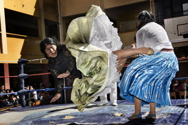Women Wrestlers, Bolivia. Lucha libre (Bolivian wrestling) is one of the most popular sports in the country. Women wrestlers are known as cholitas and have in the last ten years become popular in the sport. Here, Carmen Rosa and Yulia la Pacena perform in a benefit show to raise money for the bathrooms of a school in La Paz, Bolivia, 26 June 2011