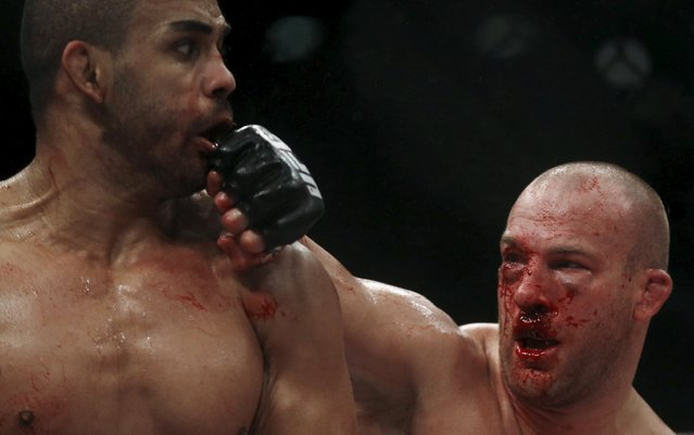 Rafael Cavalcante (L) of Brazil fights with Patrick Cummins of U.S during their Ultimate Fighting Championship (UFC) match, a professional mixed martial arts (MMA) competition in Rio de Janeiro, Brazil August 1, 2015. (Photo by Ricardo Moraes/Reuters)