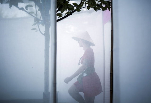 A festival-goer walks in an installation during the 23rd Sziget (Island) Festival on Shipyard Island in Budapest, Hungary, 11 August 2015. The event is one of the biggest cultural events of Europe, offering art exhibitions, theatrical and circus performances and music concerts. Almost 200 performers from 47 countries will entertain the hundreds of thousands of visitors from 11 to 18 August. (Photo by Balazs Mohai/EPA)