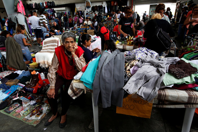A woman sells second-hand clothes in a market in Caracas, Venezuela, June 26, 2016. (Photo by Mariana Bazo/Reuters)