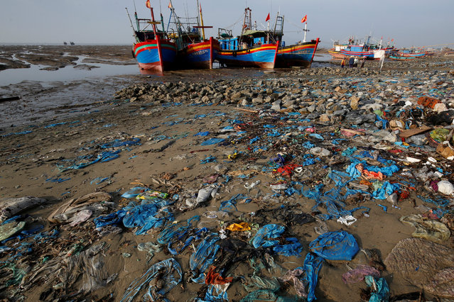 Fishermen boats are seen at a beach covered with plastic waste in Thanh Hoa province, Vietnam on June 4, 2018. (Photo by Nguyen Huy Kham/Reuters)