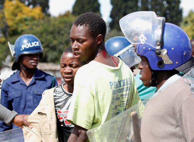 Riot police detain residents of Epworth suburb after a protest by taxi drivers turned violent in Harare, Zimbabwe, July 4,2016. (Photo by Philimon Bulawayo/Reuters)