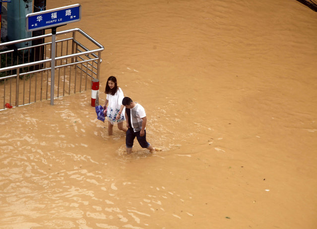 Residents walk at a flooded area as Typhoon Nepartak brings heavy rainfall in Putian, Fujian Province, China, July 9, 2016. (Photo by Reuters/Stringer)