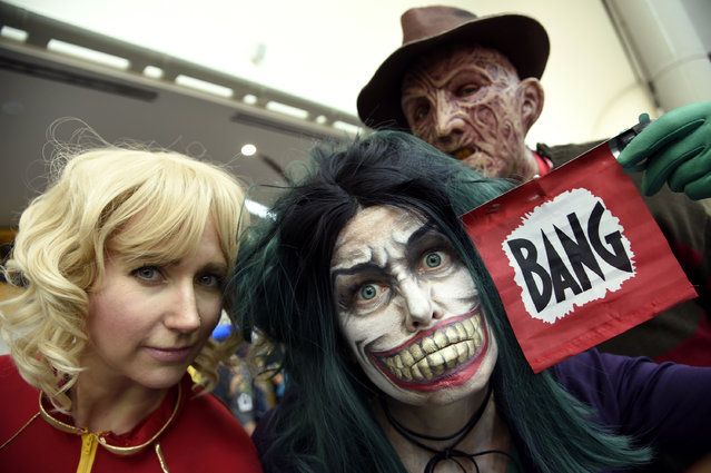 Fans dressed as Captain Marvel, from left, The Joker and Freddy Krueger attend day 1 of Comic-Con International on Thursday, July 21, 2016, in San Diego. (Photo by Chris Pizzello/Invision/AP Photo)