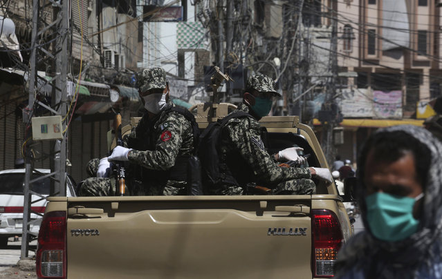 Soldiers patrol to enforce a government imposed a nationwide lockdown to try to contain the outbreak of the coronavirus, in Peshawar, Pakistan, Thursday, April 2, 2020. (Photo by Muhammad Sajjad/AP Photo)