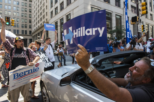 A Hillary Clinton supporter yells at pro-Bernie Sanders protesters gathered outside City Hall in Philadelphia on July 25, 2016. (Photo by Michael Robinson Chavez/The Washington Post)