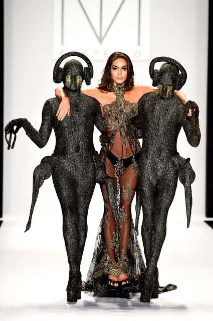 Models walk the runway in a design by MT Costello at the Art Hearts fashion show presented by AIDS Healthcare Foundation during Mercedes-Benz Fashion Week Spring 2015 at The Theatre at Lincoln Center, September 11, 2014, in New York City. (Photo by Frazer Harrison/Getty Images)