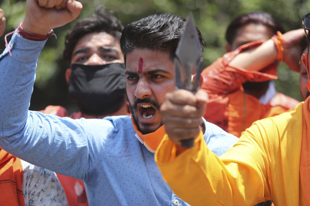 Activists of Rashtriya Bajrang Dal shout slogans during a protest against the Chinese government in Jammu, India, Wednesday, June 17, 2020. As some commentators clamored for revenge, India's government was silent Wednesday on the fallout from clashes with China's army in a disputed border area in the high Himalayas that the Indian army said claimed 20 soldiers' lives. An official Communist Party newspaper said the clash occurred because India misjudged the Chinese army's strength and willingness to respond. (Photo by Channi Anand/AP Photo)