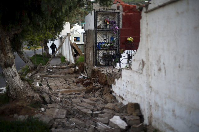 A wall of a local cemetery lies on the ground after an earthquake hit areas of central Chile, in Illapel town, north of Santiago, Chile, September 17, 2015. (Photo by Ivan Alvarado/Reuters)