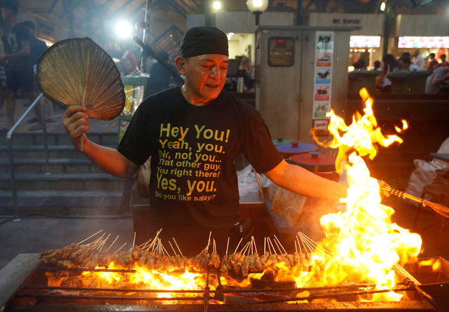 A stall helper mans a satay stand at Lau Pa Sat food centre in Singapore July 29, 2016. (Photo by Edgar Su/Reuters)