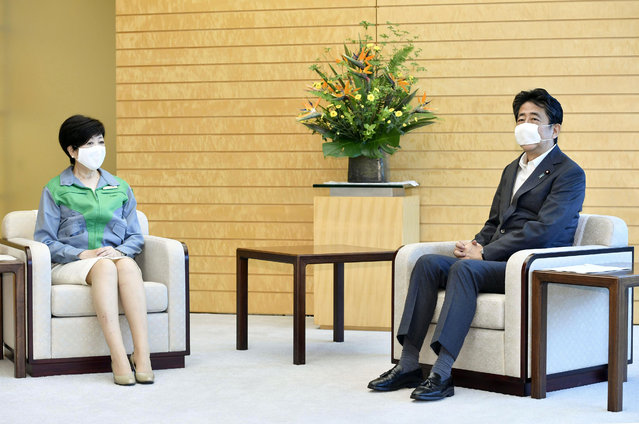 Tokyo Gov. Yuriko Koike, left, talks with Japanese Prime Minister Shinzo Abe at the prime minister's office in Tokyo Monday, July 6, 2020. Gov. Koike, who won her second term to head the Japanese capital in Sunday's election, met with her political rival, Prime Minister Abe and agreed to cooperate in their effort to fight against the coronavirus and to safely achieve the Olympics next year. (Photo by Yoshitaka Sugawara/Kyodo News via AP Photo)