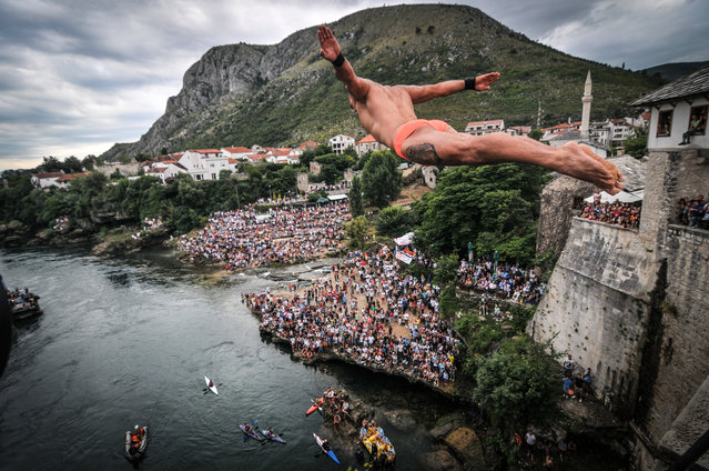 """Traditional Mostar jumps from Old bridge"". Lorens Listo is a eight-time champion of traditional Mostar rebounds from the Old Bridge. In the minds of most sane people, jumping off tall bridges is a way to die – but in Mostar, Bosnia-Hercegovina, it's a way of life. Photo location: Mostar, Federation of Bosnia and Herzegovina. (Photo and caption by Haris Begić/National Geographic Photo Contest)"