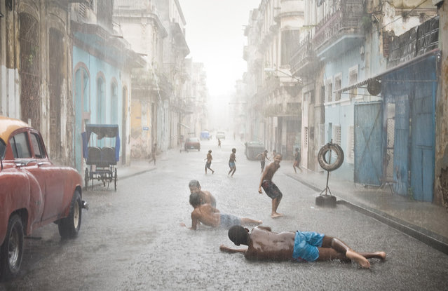 """""""Havana, Cuba. Havana weather in July and August counts as brutally hot. Short but heavy rains are very common and welcomed by locals, especially kids"""". (Photo and comment by Val Proudkii, USA/2013 Sony World Photography Awards"""