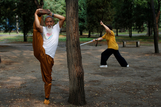 Kung Fu master Li Liangui practices 'Suogugong' Kung Fu and his wife Liang Xiaoyan (R) practices Qigong at a park in Beijing, China, June 30, 2016. (Photo by Kim Kyung-Hoon/Reuters)
