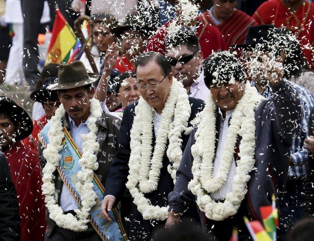 "U.N. Secretary-General Ban Ki-moon (C), Bolivia's President Evo Morales (R) and Vila Vila's Mayor Emiliano Reyes Garcia arrive at the inauguration of a sports arena called ""Coliseo Ban Ki-Moon"" in Vila Vila, south of Cochabamba, October 11, 2015. (Photo by David Mercado/Reuters)"