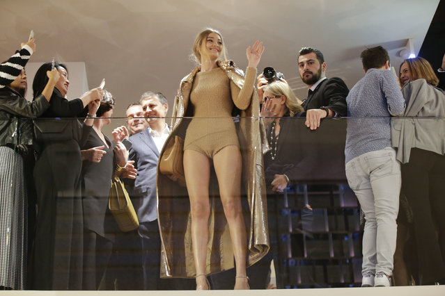 Model Gigi Hadid, hosted by Max Mara, waves to fans from the flagship store during the women's Spring-Summer 2017 fashion event, in Milan, Italy, Wednesday, September 21, 2016. (Photo by Luca Bruno/AP Photo)