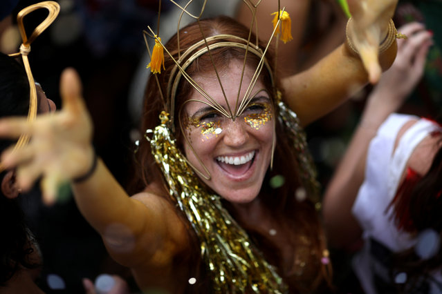 """A reveller takes part in an annual block party known as """"Ceu na Terra"""" (Heaven on Earth), during carnival festivities in Rio de Janeiro, Brazil February 3, 2018. (Photo by Pilar Olivares/Reuters)"""