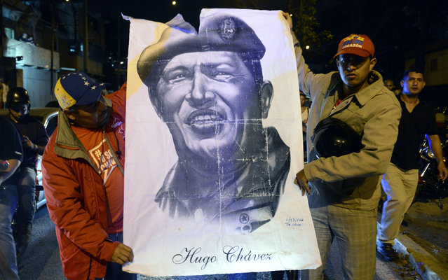 Venezuelan President Hugo Chavez hold design in support of the president of Venezuela, who died on Tuesday. (Photo by Juan Barreto/AFP Photo)