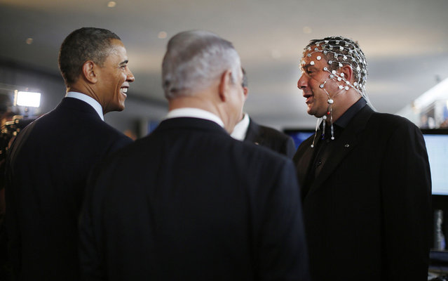 U.S. President Barack Obama (L) and Israeli Prime Minister Benjamin Netanyahu (C) speak with Professor Amir Geva (R), head of the biomedical signal processing and pattern recognition lab at the Ben-Gurion University of the Negev, as they tour a technology expo at the Israel Museum in Jerusalem, on March 21, 2013. (Photo by Jason Reed/Reuters)