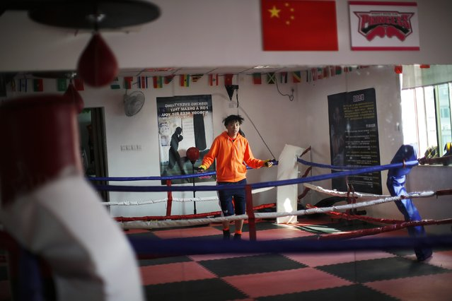 Vin Huang warms up before a boxing class at Princess Women's Boxing Club in Shanghai December 6, 2014. (Photo by Carlos Barria/Reuters)