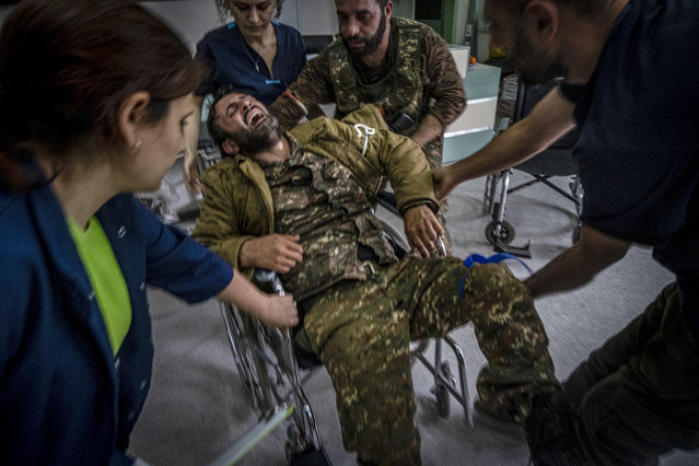 A soldier is taken into a hospital after being wounded at the front-line in the outskirts of Stepanakert, Nagorno-Karabakh, Friday, November 6, 2020. (Photo by Ricard Garcia Vilanova/AP Photo)