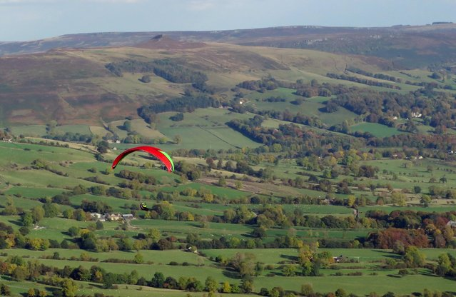A paraglider takes off from Mam Tor near Castleton, central England, October 19, 2015. (Photo by Darren Staples/Reuters)