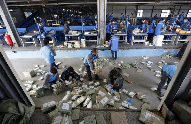 Employees work at a sorting centre of Zhongtong (ZTO) Express ahead of the Singles Day shopping festival, Chaoyang District, Beijing, November 8, 2015. (Photo by Jason Lee/Reuters)