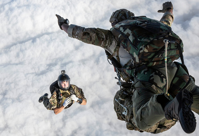 Personnel, 2nd place. A parachute jump instructor films a soldier carrying out a qualifying freefall jump as part of Exercise Quick Glass. (Photo by Cpl Ben Tritta/2020 RAF Photo Competition)