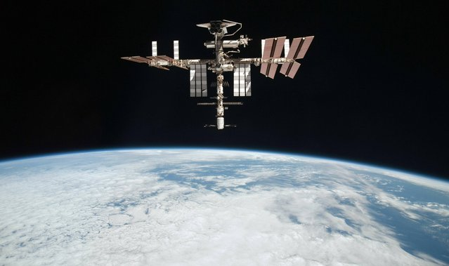 This May 23, 2011 file photo released by NASA shows the International Space Station at an altitude of approximately 220 miles above the Earth, taken by Expedition 27 crew member Paolo Nespoli from the Soyuz TMA-20 following its undocking. NASA on Thursday, May 9, 2013 said the International Space Station has a radiator leak in its power system. The outpost's commander calls the situation serious, but not life-threatening. (Photo by Paolo Nespoli/AP Photo/NASA)