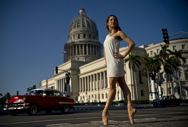 In this April 14, 2018 photo, National Ballet of Cuba dancer Daniela Gomez Perez stands on point as she poses outside the Capitol in Havana, Cuba. Gomez, who says Cubans love dancing, trusts the next generation of leaders will continue such traditions and that art will continue to be the engine of Cuban society. Gomez said she is proud to represent Cuba during a dance trip in May to Washington, Tampa and Chicago, and that the Cuban state has always supported dance. (Photo by Ramon Espinosa/AP Photo)