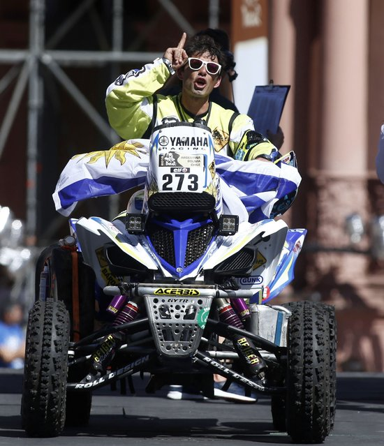 Uruguay's Mauro Almeida rides his Yamaha quad during the departure ceremony of the Dakar Rally 2015 in front of the Casa Rosada Presidential Palace in Buenos Aires January 3, 2015. (Photo by Marcos Brindicci/Reuters)