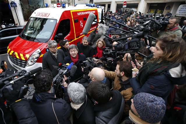 Jean-Luc Melenchon, member of the French far-left Parti de Gauche, speaks to the media as he arrives at the scene after a shooting at the Paris offices of Charlie Hebdo January 7, 2015. The French President  headed to the scene of the attack and the government said it was raising France's security level to the highest notch. (Photo by Charles Platiau/Reuters)