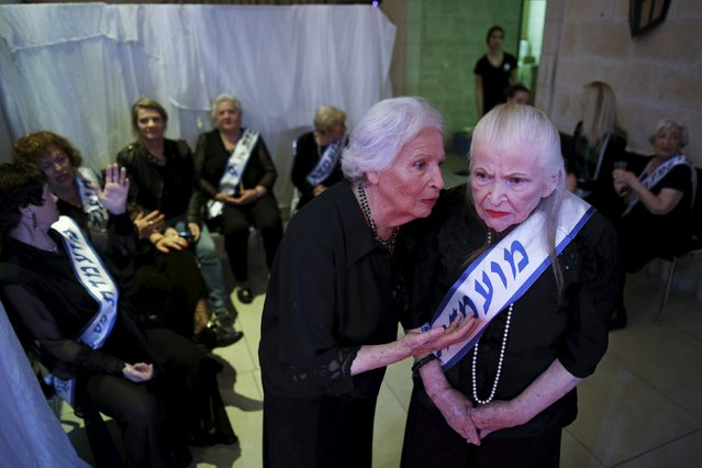 Holocaust survivors are seen backstage during a beauty contest for survivors of the Nazi genocide in the northern Israeli city of Haifa, November 24, 2015. Thirteen women took part in the third annual beauty contest for Holocaust survivors in Israel on Tuesday. (Photo by Amir Cohen/Reuters)