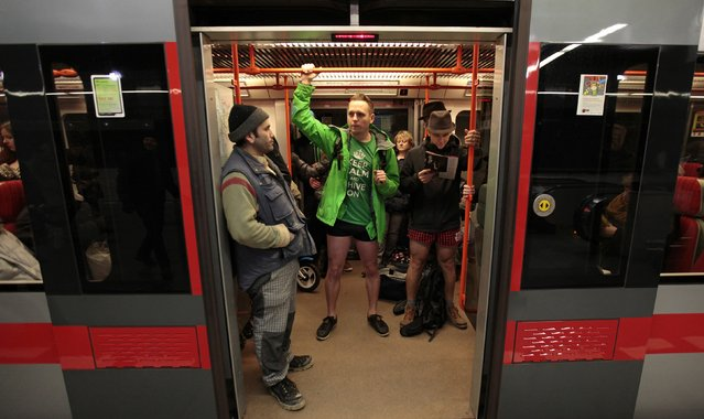 """Passengers not wearing pants stand in a subway train during the """"No Pants Subway Ride"""" in Prague January 11, 2015. (Photo by David W. Cerny/Reuters)"""