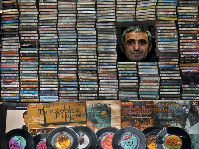 """""""Music Collector"""". Ahmet is a record seller who loves music very much. He has a small and charming shop and he makes collection of long-play records. He spends his life on music and its changes, and he is very happy with the old melodies. Location: Degirmendere, Kocaeli. (Photo and caption by Melih Sular/National Geographic Traveler Photo Contest)"""