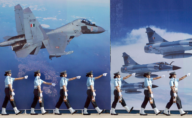Aeronautical Engineers of the Air Force Technical College (AFTC) of the Indian Air Force take part in a passing out parade in Bangalore on December 4, 2015.   The Parade marks the culmination of 74 weeks of training in Aeronautical Engineering, Military Leadership, Managerial Skills and Ethos of an air warrior. The passing out batch comprised 136 officers, including 37 women and 11 international officers. (Photo by Manjunath Kiran/AFP Photo)