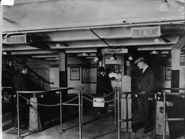 A man gets change in nickels from a change booth operator so he can pass through the new nickel-operated turnstiles which have replaced the ticket and ticket-chopper (a man who manually cut tickets at the gate) system in the New York City subway, early 1920s. The move allowed subway companies to reduce operating costs by drastically reducing personnel. (Photo by FPG/Getty Images)