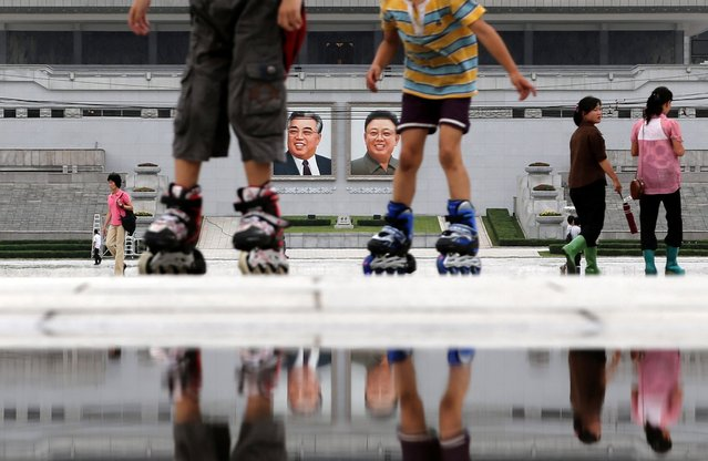 Children skate around the Kim Il Sung Square on Sunday, July 21, 2013, downtown Pyongyang, North Korea. The country is preparing to mark the 60th anniversary of the end of the Korean War. (Photo by Wong Maye-E/AP Photo)