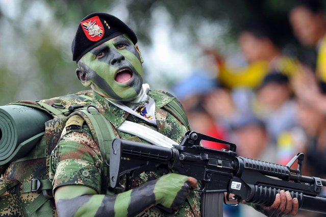 A special forces soldier parades during the celebrations of the 203rd Anniversary of the Independence of Colombia, in Bogota, Colombia, on July 21, 2013. (Photo by Guillermo Legaria/AFP Photo)