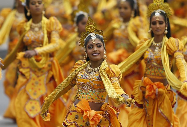 Traditional dancers perform during Sri Lanka's 67th Independence day celebrations in Colombo February 4,2015. (Photo by Dinuka Liyanawatte/Reuters)