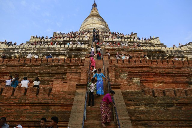 People wait to see the sunset from the top of Shwesandaw Pagoda in the ancient city of Bagan February 13, 2015. (Photo by Soe Zeya Tun/Reuters)