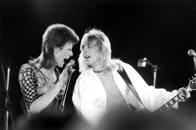 David Bowie performing with guitarist Mick Ronson (1946 - 1993) at a live recording for a Midnight Special TV show made at The Marquee Club in London with a specially invited audience of Bowie fanclub members, 21st October 1973. (Photo by Jack Kay/Daily Express/Hulton Archive/Getty Images)