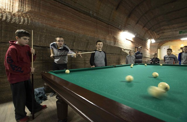 Children play billiards in the facilities of Belarus' Republican Clinic of Speleotherapy within a salt mine, as part of their treatment, near the town of Soligorsk, south of Minsk, February 19, 2015. (Photo by Vasily Fedosenko/Reuters)