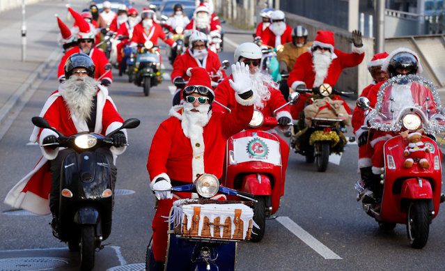 Members of a Vespa Fan Club dressed as Santa Claus (Samichlaus) ride on their scooters in Zurich, Switzerland December 4, 2016. (Photo by Arnd Wiegmann/Reuters)